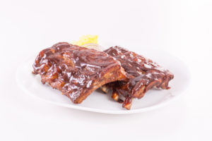 Ribs plated with sauce